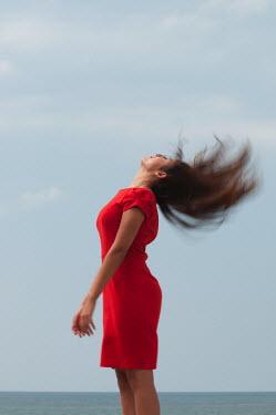 Mohamad Itani WOMAN RED DRESS SHAKING HEAD Women