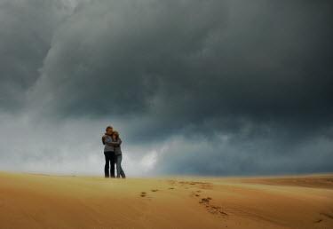 Terry Bidgood COUPLE EMBRACING SAND STORM CLOUDS Couples