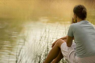Laura Franco WOMAN SITTING BY LAKE Women
