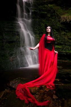 Paul Webster WOMAN LONG RED DRESS STANDING WATERFALL Women