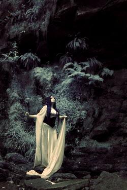 Paul Webster WOMAN STANDING WHITE DRESS ROCKS Women