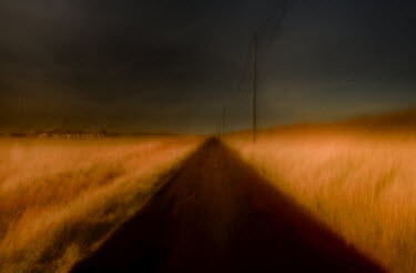 Chris Friel A ROAD THROUGH A FIELD Roads