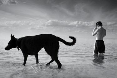 Chris Friel BOY AND DOG IN WATER Children