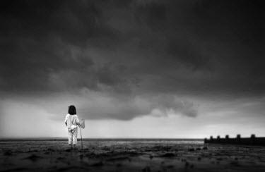 Chris Friel SMALL GIRL STANDING ON BEACH Children