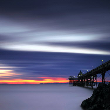 Gary Newman PIER, SUN SETTING IN BACKGROUND Seascapes/Beaches