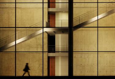 Ralph Graef WOMAN WALKING MODERN BUILDING Women