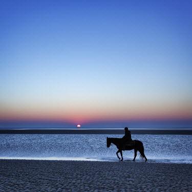 Ralph Graef MAN RIDING HORSE SEA SUNSET Men