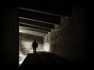 Ralph Graef MAN WALKING TUNNEL SHADOW Men