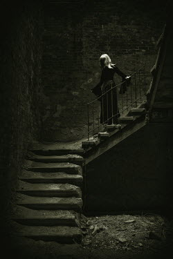 Ralph Graef blonde woman on dark staircase Women