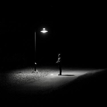 Lara Alegre man illuminated by streetlight Men