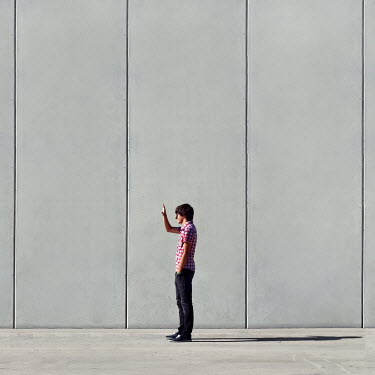 Lara Alegre young man standing next to bare wall Men