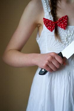 Lee Avison GIRL STOOD HOLDING KITCHEN KNIFE Children