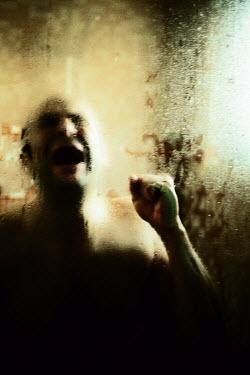 Sally Mundy man screaming behind windowpane Men
