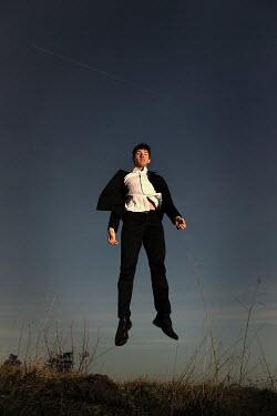 Stephen Carroll MAN JUMPING OUTSIDE Men