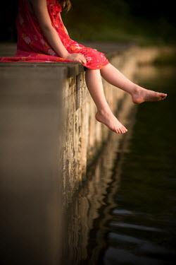 Lee Avison GIRL DANGLING FEET OVER WATER Children
