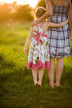 Lee Avison MOTHER AND CHILD HUGGING IN FIELD Children