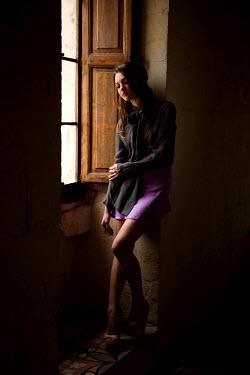 Rebecca Miller WOMAN LEANING AGAINST WALL BY WINDOW Women
