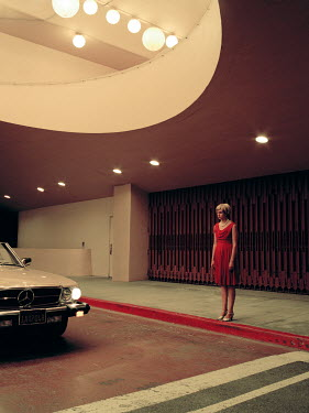 Rebecca Miller BLONDE WOMAN IN MODERN BUILDING WITH CAR Women