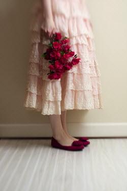 Susan Fox WOMAN STANDING IN LACY DRESS HOLDING FLOWERS Women