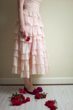 Susan Fox WOMAN IN LACY DRESS DROPPING FLOWERS Women