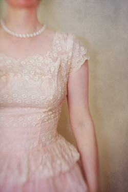 Susan Fox WOMAN STANDING IN LACY DRESS WITH PEARLS Women