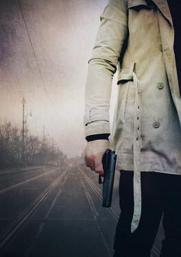 Mark Owen man standing on road holding gun Men