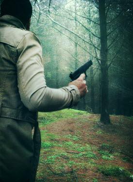 Mark Owen man with gun in forest Men