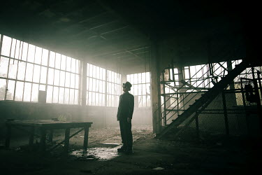Christophe Dessaigne DERELICT INDUSTRIAL WAREHOUSE WITH MAN Miscellaneous Buildings
