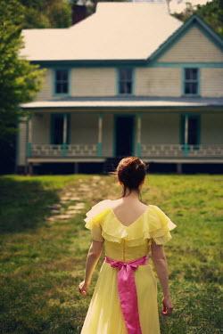 Susan Fox WOMAN IN DRESS OUTSIDE WEATHERBOARD HOUSE Women