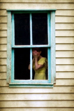 Susan Fox WOMAN CRYING IN WINDOW OF WEATHERBOARD HOUSE Women