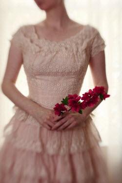 Susan Fox WOMAN IN PALE DRESS HOLDING FLOWERS Women