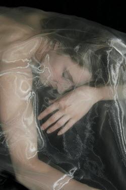 Ilona Wellmann WOMAN LYING UNDER GOSSAMER  MATERIAL Women