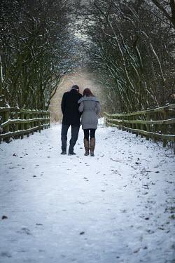 Lee Avison COUPLE WALKING IN SNOW Couples