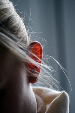 Adrian Muttitt BLONDE WOMAN'S EAR Body Detail