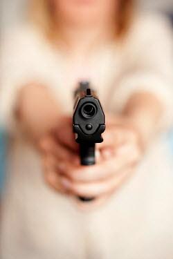 Valentino Sani BLONDE WOMAN POINTING GUN Women