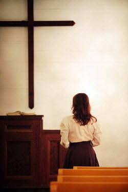 Susan Fox DARK HAIRED WOMAN STANDING IN CHURCH Women