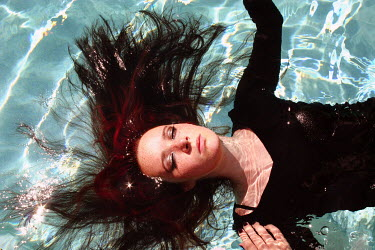Taylor Dawn Fortune DARK HAIRED WOMAN FLOATING IN SWIMMING POOL Women