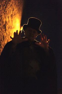 Neil Denham VICTORIAN MAN IN TOP HAT AT NIGHT Men