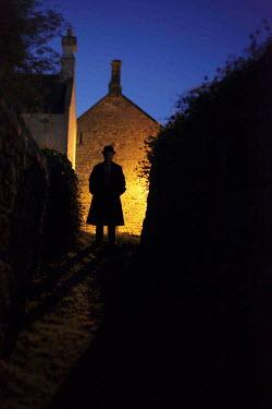 Neil Denham EDWARDIAN MAN STANDING IN LANE AT NIGHT Women