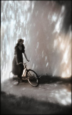 Gary Isaacs WOMAN RIDING BICYCLE IN SUMMER Women