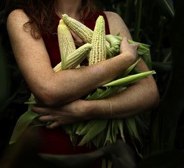 Stephen Carroll RED HAIRED WOMAN HOLDING CORN Women
