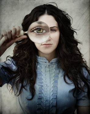 Vanesa Munoz WOMAN LOOKING THROUGH MAGNIFYING GLASS Women