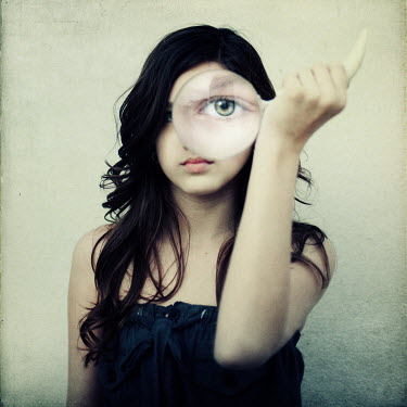 Vanesa Munoz WOMAN STARING THROUGH MAGNIFYING GLASS Women