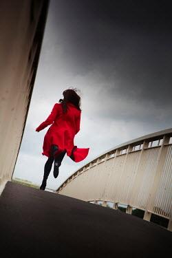 Andy & Michelle Kerry WOMAN IN RED COAT RUNNING OVER BRIDGE Women