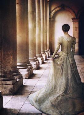 Mark Owen Woman walking along colonnade Women