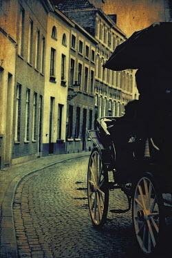Irene Lamprakou HISTORIC CARRIAGE ON STREET Streets/Alleys