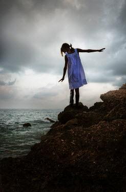 Yolande de Kort Girl on rocks Children