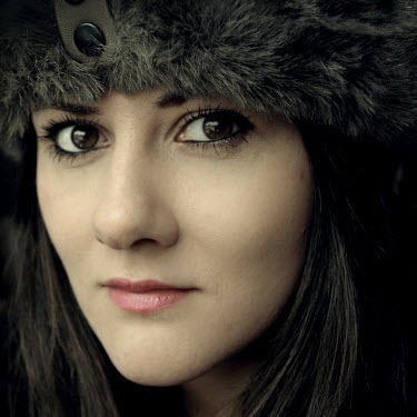 Dylan Kitchener FACE OF DARK HAIRED WOMAN WITH FUR HAT Women