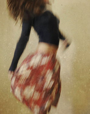 Dylan Kitchener DARK HAIRED WOMAN DANCING IN SKIRT Women