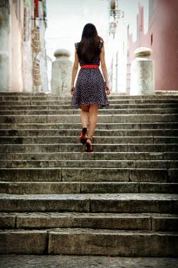 Yolande de Kort WOMAN WALKING UP STONE STEPS Women